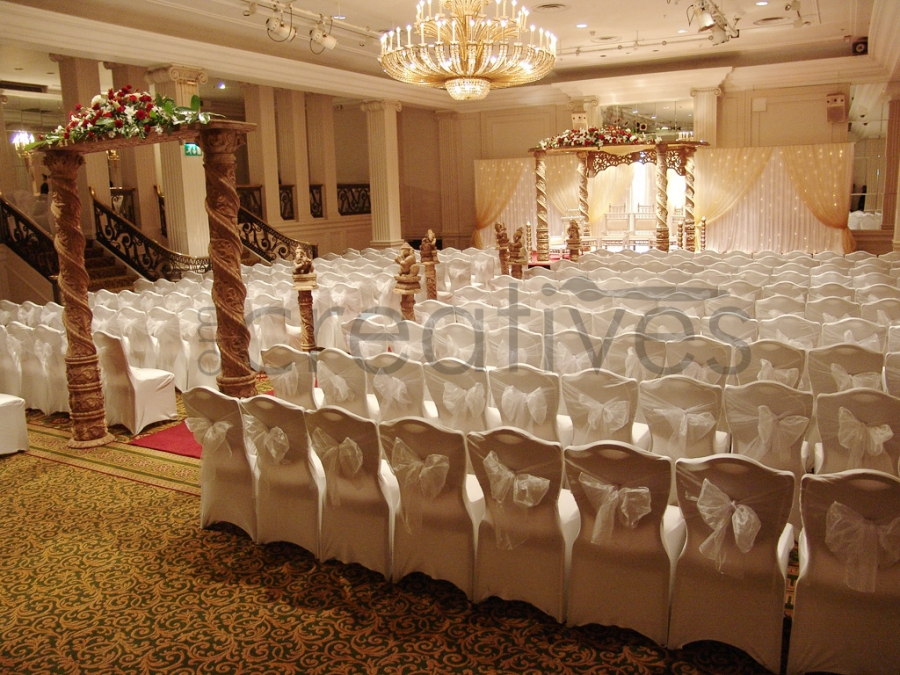Category om creatives london for Asian wedding stage decoration london